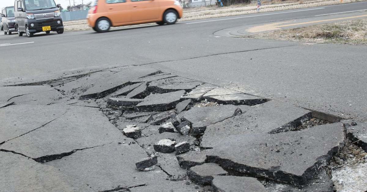 A damaged road is seen on March 13, 2011, in Sendai, Japan, after an 8.9 magnitude earthquake struck on March 11 off the coast of northeastern Japan.</p>
