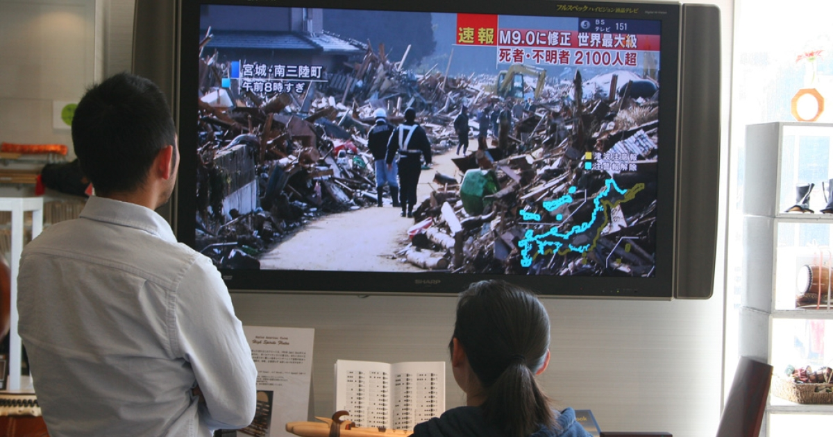 Residents of Hakusan City in western Japan watch images of the catastrophic earthquake and tsunami damage on television.</p>