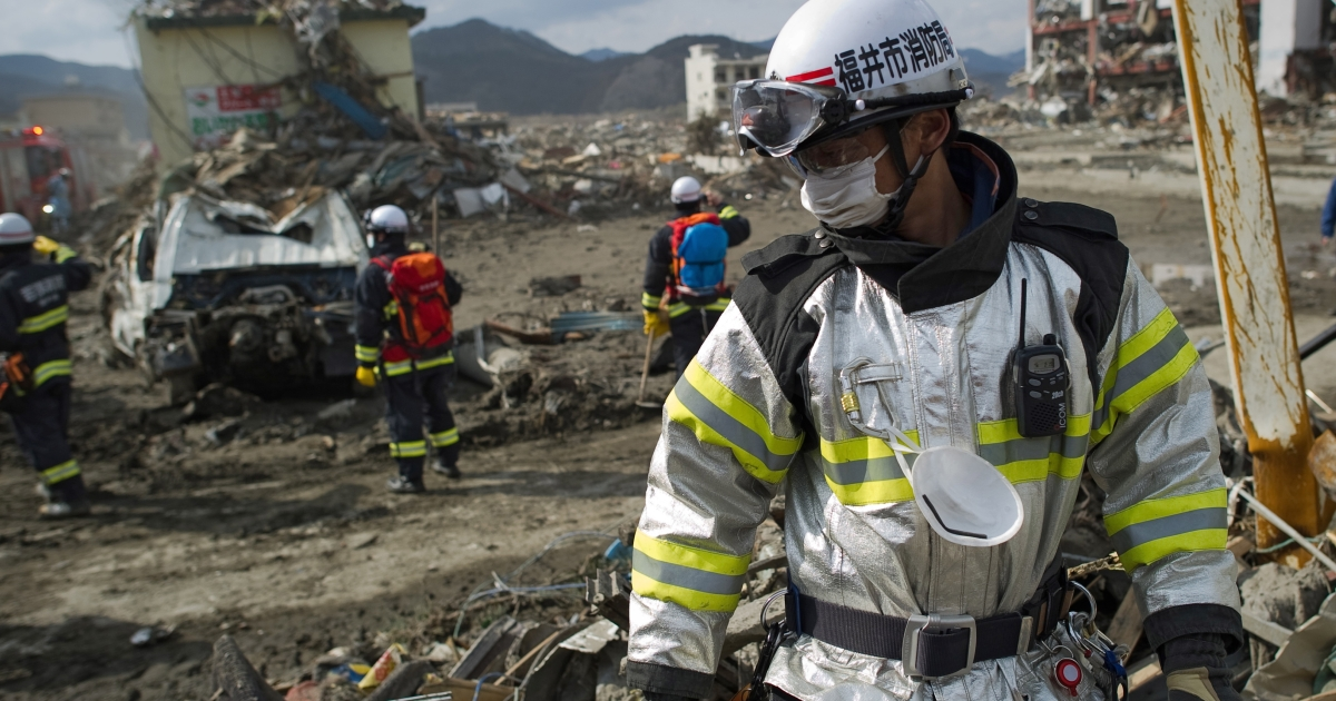 Members of a Japanese rescue team look through debris for bodies from the March 11 tsunami and earthquake in the city of Rikuzentakata in Iwate prefecture on March 19, 2011. In an updated toll, national police said at least 18,000 were dead or missing in Japan's worst natural disaster in 88 years.</p>