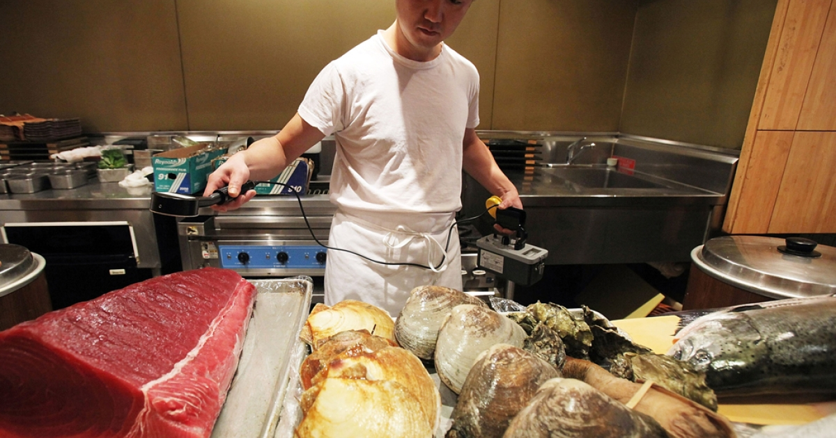 A sushi chef uses a radiation detector on seafood before it is prepared in Manhattan's Sushi Yasuda restaurant.</p>