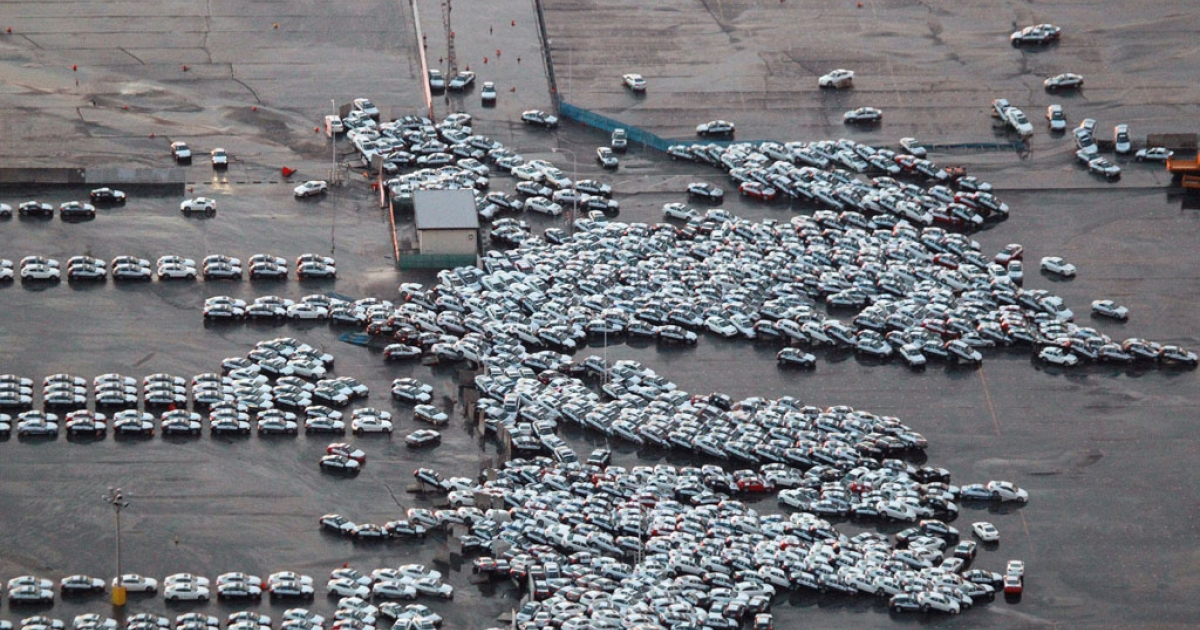 An aerial shot shows vehicles ready for shipping being carried by a tsunami tidal wave at Hitachinaka city in Ibaraki prefecture on March 11, 2011.</p>
