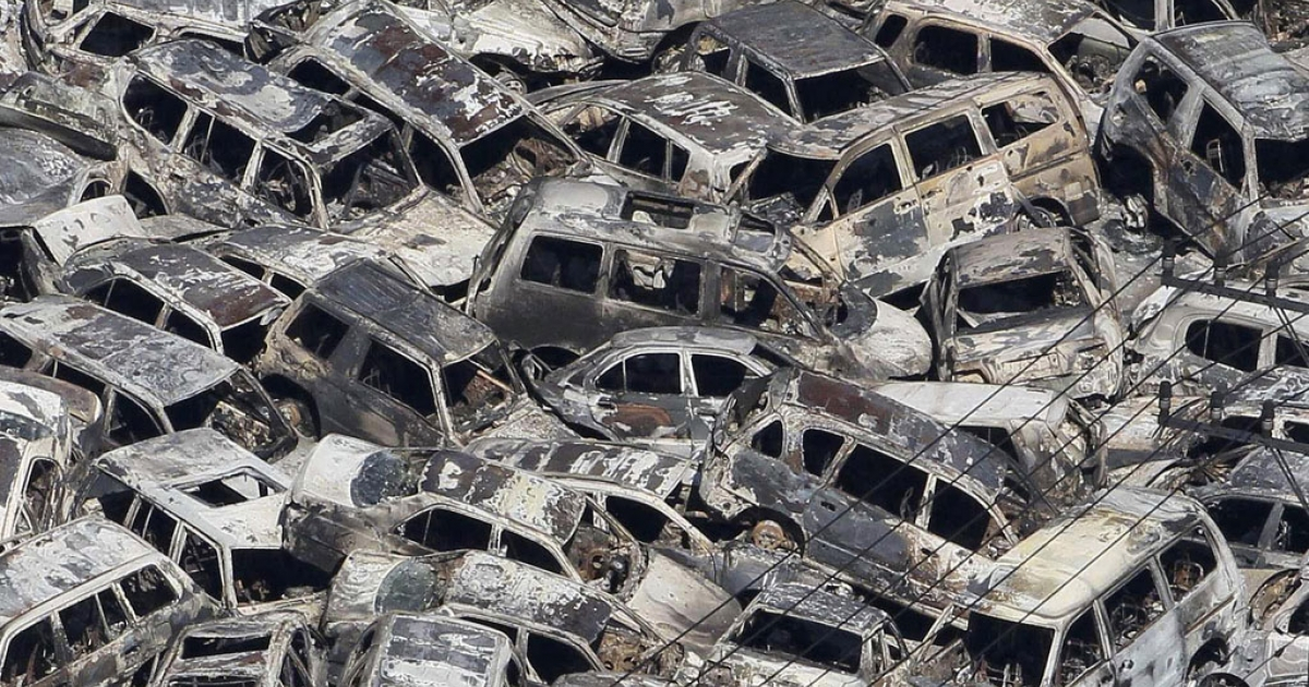 In a picture taken March 12, 2011, tsunami-damaged vehicles that were parked for export are piled at a port in Ibaraki prefecture, Japan.</p>