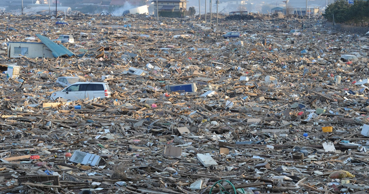 Debris cover a large area in Natori, near Sendai in Miyagi prefecture on March 13, 2011 after the March 11 earthquake and tsunami.</p>