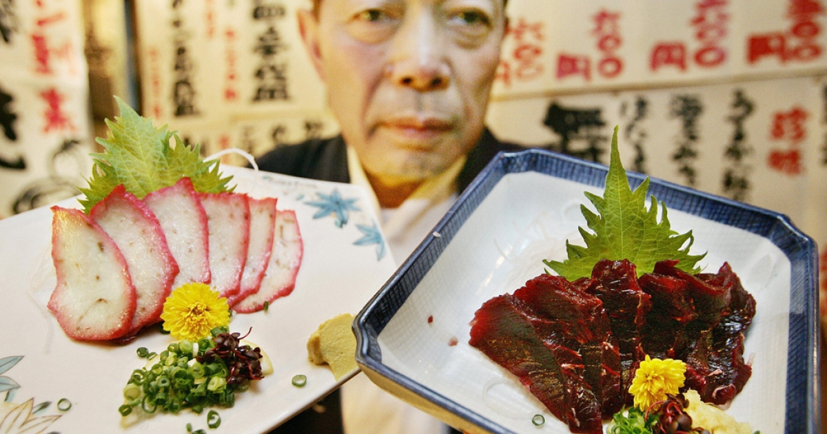 Shunichi Arita, manager of Japanese-style restaurant chain Taruichi, serves whale sashimi at his restaurant in Tokyo's red-light district Kabukicho.</p>