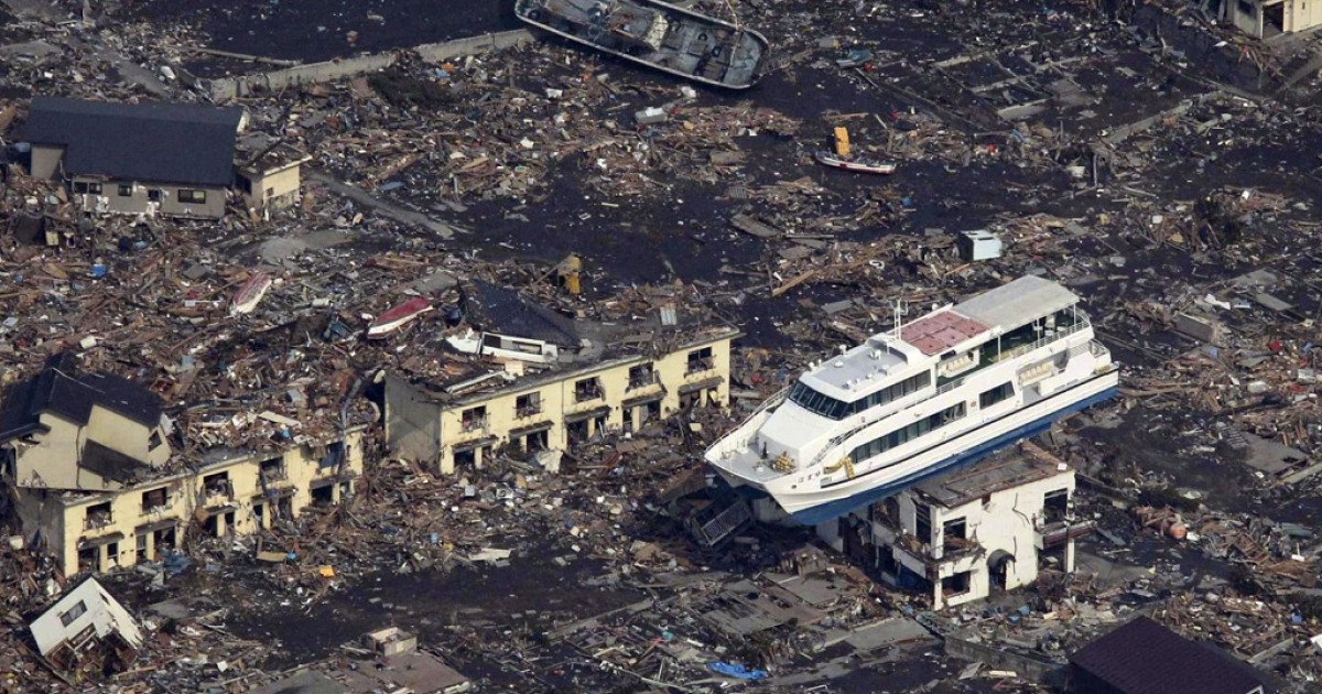 An aerial shot shows a pleasure boat sitting on top of a building amid a sea of debris in Otsuchi town in Iwate prefecture on March 14, 2011.</p>