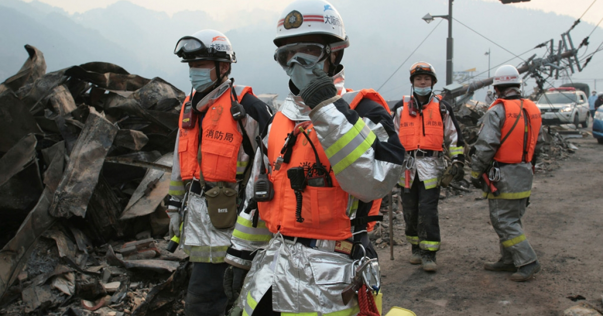 Firefighters join search and rescue efforrts on the northeast coast of Japan on March 14, 2011.</p>