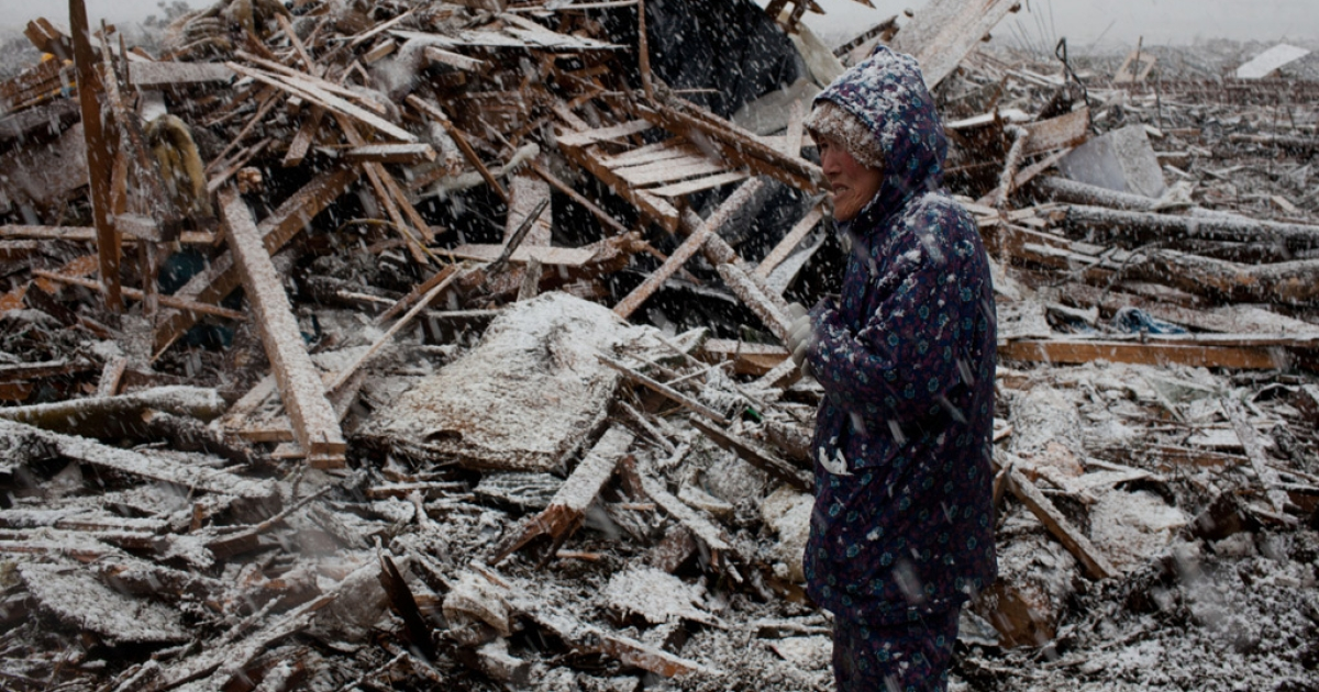 Yukiko Kometa, 74 years old, stands in front of her tsunami devastated house at Noda village, Iwate prefecture on March 27, 2011.</p>