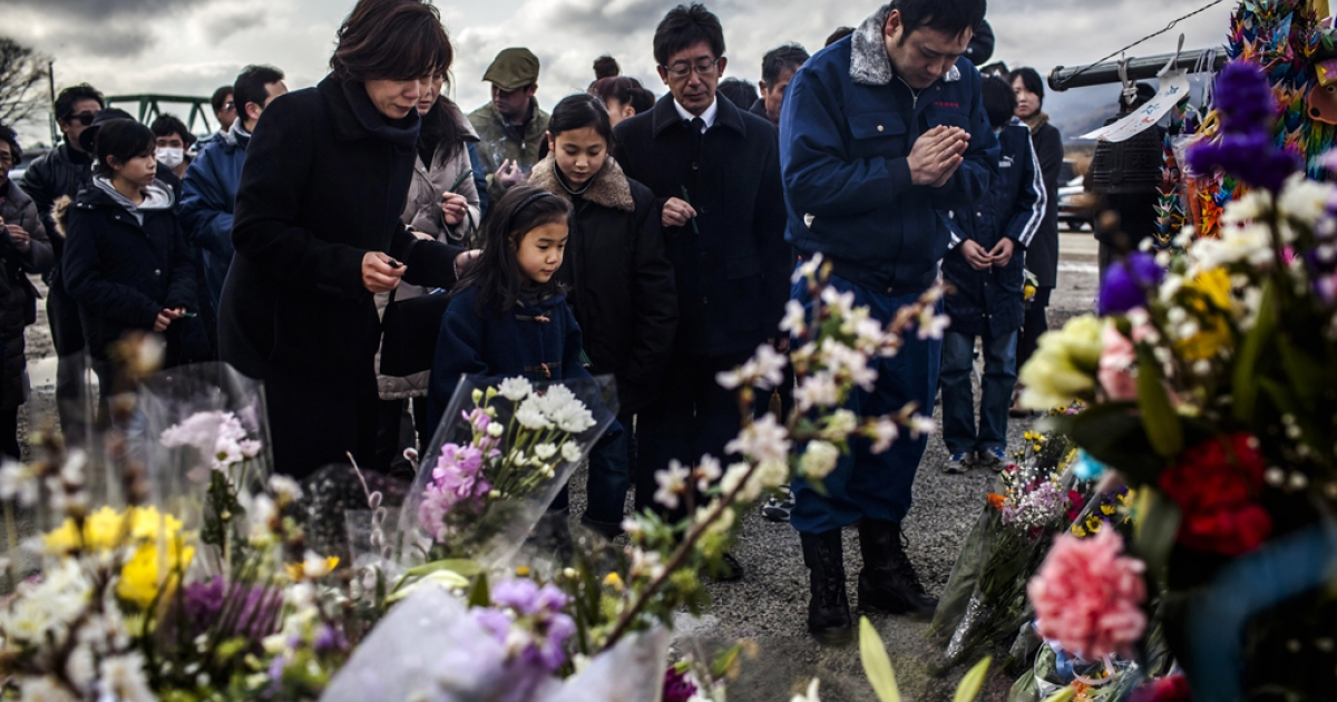 A family pay their respects to victims of the last year's tsunami at a memorial, on March 11, 2012 near Ishinomaki, Japan. There was a 6.8-magnitude earthquake three days later off the coast of northeastern Japan, on March 14, 2012. No major damage was reported and a tsunami advisory was withdrawn shortly after being issued.</p>