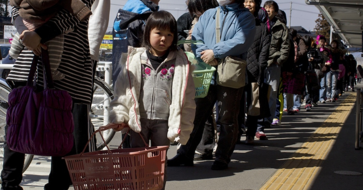 Japanese wait in line for a supermarket to open to buy food items which are in low supply March 23, 2011, in Ichinoseki, Japan.</p>