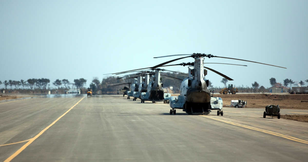 US Marines helicopters queue on a runway at Sendai Airport, Miyagi prefecture, on March 30, 2011. US airmen in a hulking C-130 Hercules cargo plane had delivered containers of badly-needed fuel to Japan's tsunami-ravaged northeast as part of a massive military aid effort.</p>