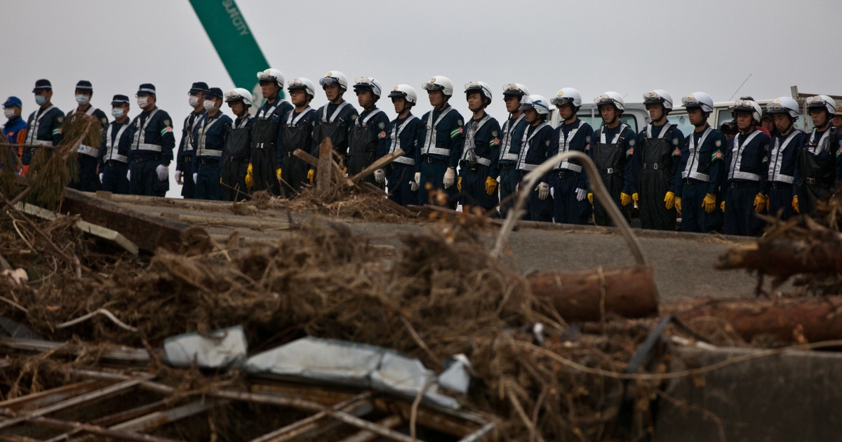 A month after the devastating tsunami, Japanese police officers have a moment of silence at the time of 2:46 when the earthquake hit the country in Ishinomaki, Miyagi prefecture on April 11, 2011. Japan said it was to widen the evacuation area around a crippled nuclear plant to include territory outside the current 12-mile exclusion zone.</p>