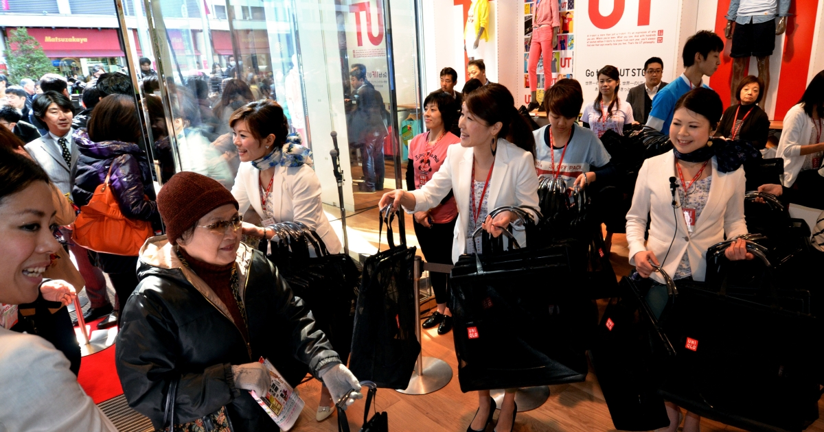 Customers enter the new flagship store of Jaspanese casual fashion giant Uniqlo.</p>