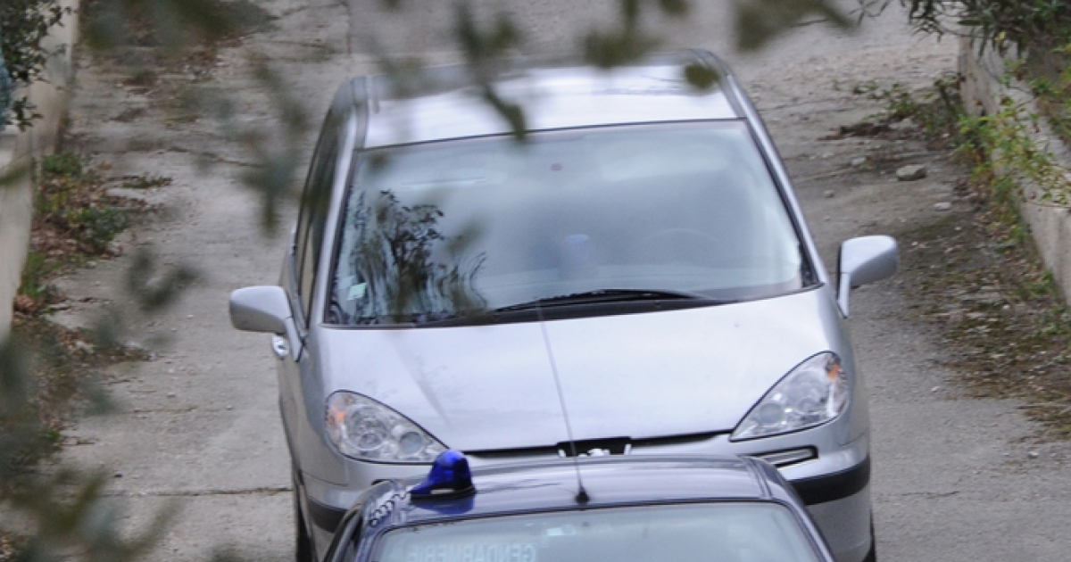 The former wife and the daughter (top) of Jean Claude Mas watch as Jean-Claude Mas leaves his companion's home in a gendarmerie car (background), on January 26, 2012 in Six-Fours-les-Plages, southern France. The President of Poly Implant Prothese (PIP), who is at the center of an international health scare, was arrested by French police. Between 400,000 and 500,000 women around the world are believed to have received implants made by PIP, the now-defunct company that Mas founded in southern France.</p>