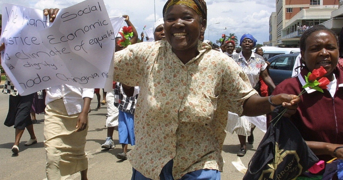 Women of Zimbabwe Arise (WOZA) protesters march through the streets of Harare, on Valentines Day, handing out roses to people, including police, and calling for love and human rights.</p>