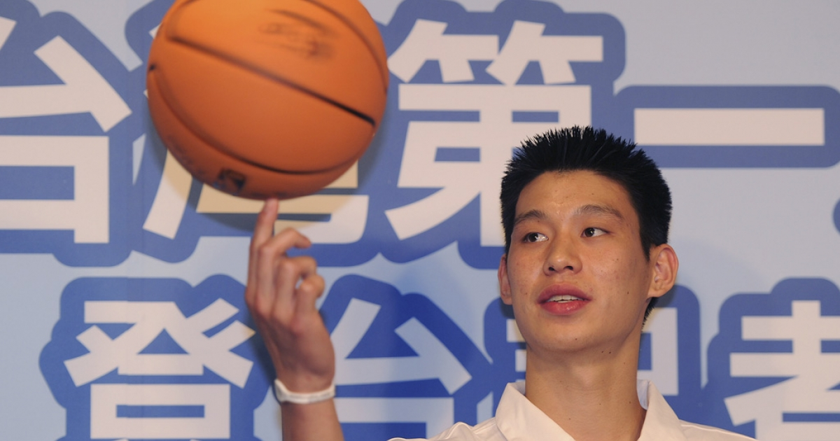 Jeremy Lin balances a basketball on his finger during a press conference in Taipei on July 28, 2010. Lin accompanied Yao Ming on a two-day trip to Taipei to promote the Yao Foundation Charity Tour.</p>