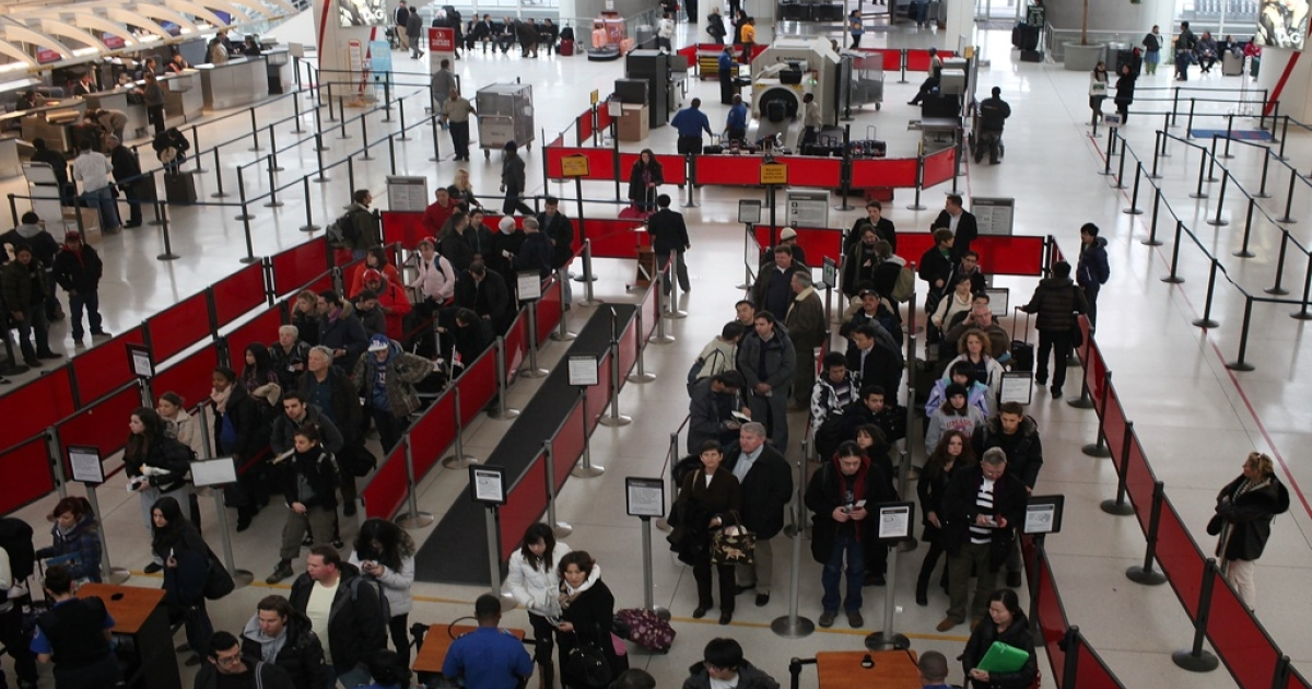 People wait in line for a security check at John F. Kennedy Airport in New York City on Dec. 23, 2010.</p>