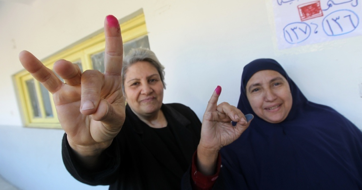 Egyptian women show they've voted. Carter said the election was fair —but the military council's been holding up progress.</p>