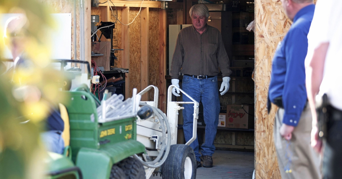 Police prepare to drill through a concrete driveway September 28, 2012 in Roseville, Michigan to obtain a soil sample that will be tested for signs of human decomposition at a site where a tipster reported that the body of former Teamsters union boss Jimmy Hoffa may be buried.</p>