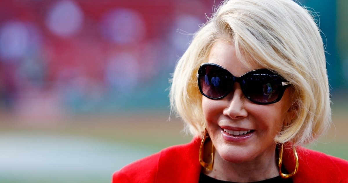 Actress Joan Rivers takes a tour of Fenway Park prior to the game between the Boston Red Sox and the Chicago White Sox on July 19, 2012 at Fenway Park in Boston, Massachusetts.</p>