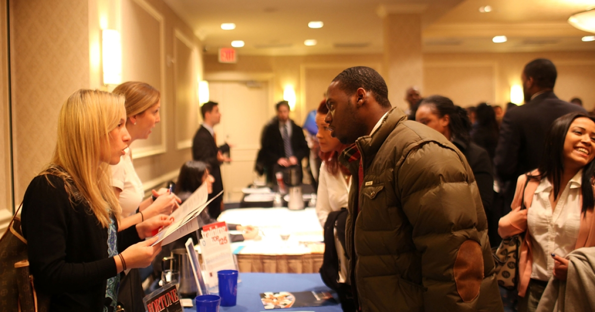 Job seekers attend a career fair in midtown Manhattan on February 6, 2012 in New York City. In further signs that the US economy is recovering, the government reported Friday that 243,000 jobs were created last month. The unemployment rate fell to 8.3 percent from 8.5 percent, its lowest level in three years.</p>
