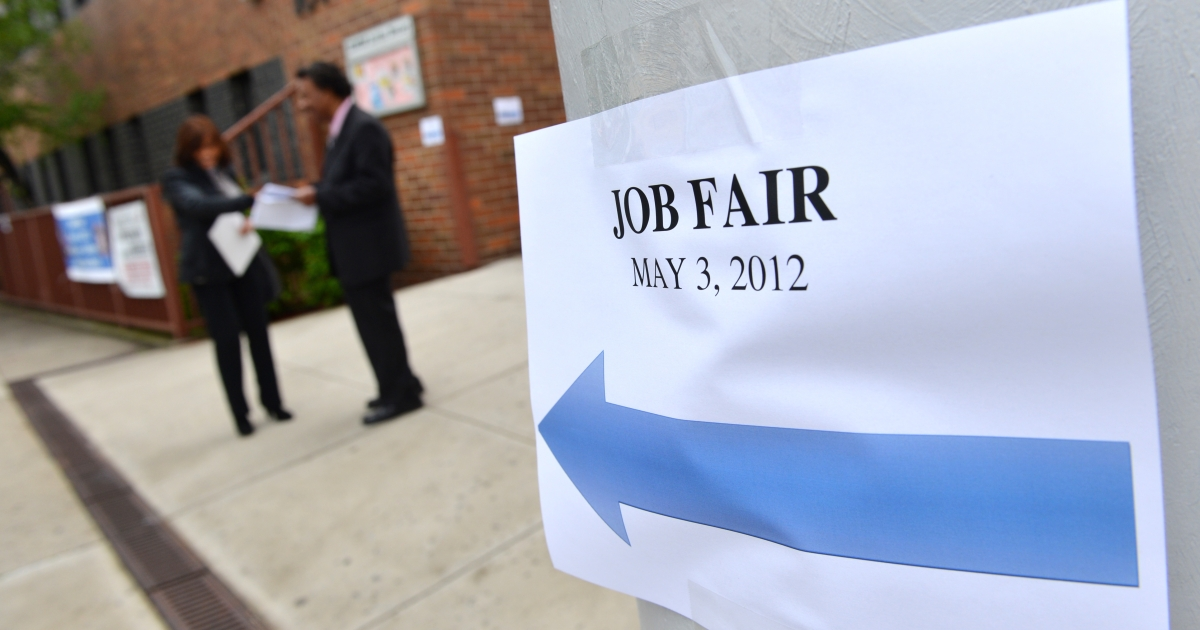 A sign points to an employment fair in the Queens borough of New York.</p>