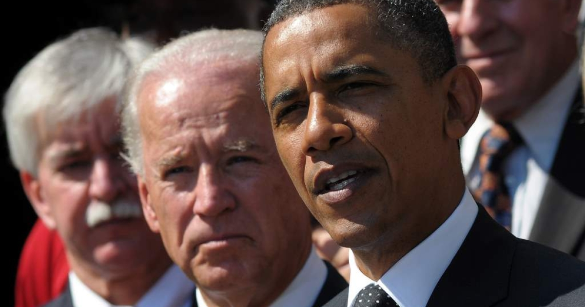 President Barack Obama speaks on the American Jobs Act as Vice President Joe Biden looks on September 12, 2011 in the Rose Garden of the White House in Washington, DC.</p>