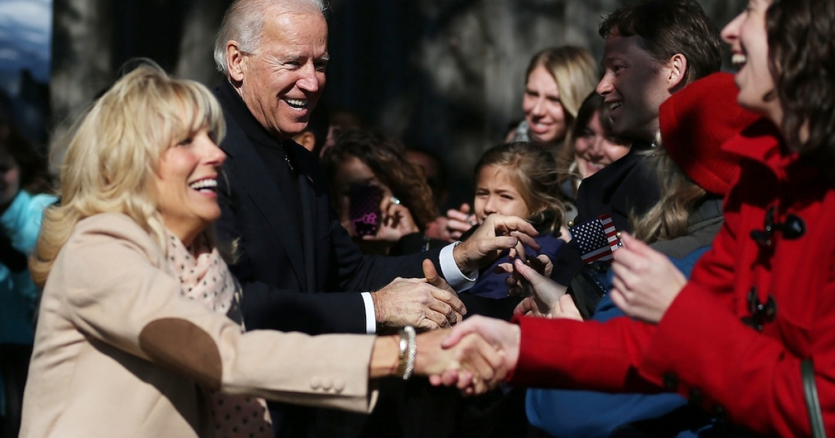 US Vice President Joseph Biden and his wife Jill Biden greet people at a campaign rally at the Heritage Farm Museum, on November 5, 2012 in Sterling, Virginia.</p>