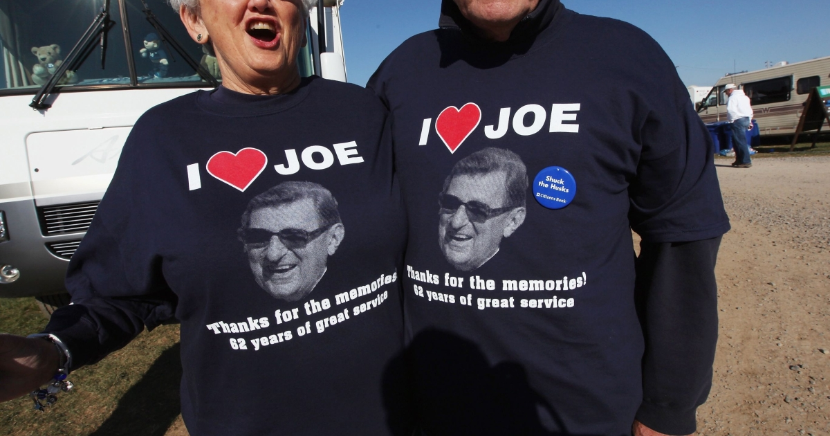 Penn State season ticket holders and 1963 graduates Pat (L) and Dan Amey wear shirts supporting Joe Paterno outside Beaver Stadium before the start of the Penn State vs. Nebraska NCAA football game in the wake of the Jerry Sandusky scandal on November 12, 2011 in State College, Pennsylvania. The Penn State head football coach was fired amid allegations that former Penn State defensive coordinator Jerry Sandusky was involved with child sex abuse.</p>