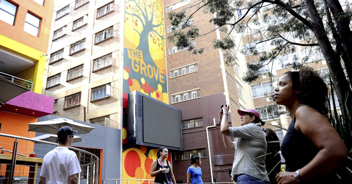 Tourists visit the Central Business District (CBD) of Johannesburg on March 11, 2012.</p>