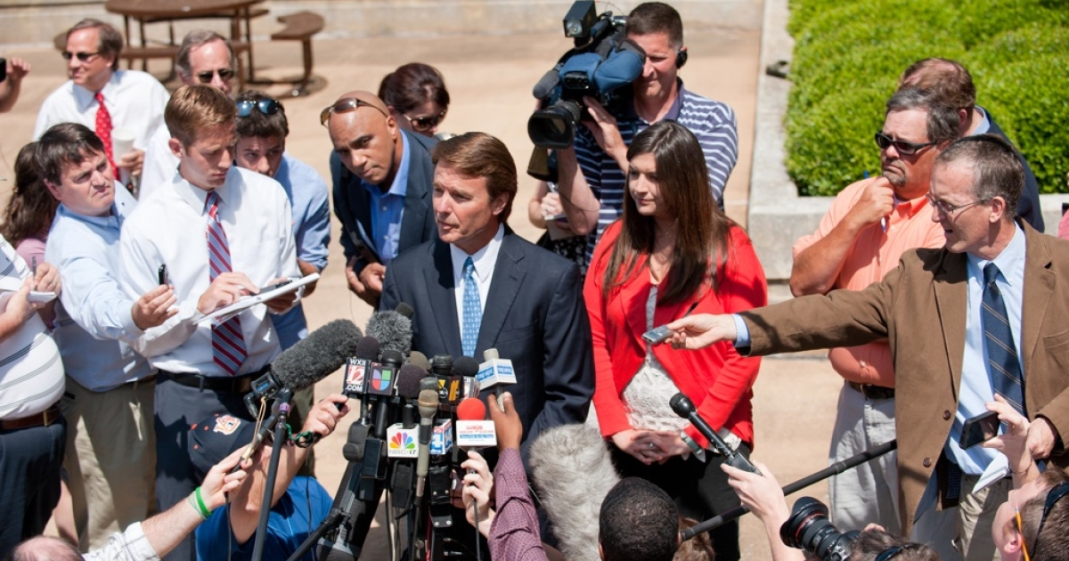 John Edwards exits the Federal Courthouse with his daughter Cate Edwards, and speaks to a crowd of reporters on June 3, 2011, in Winston Salem, N.C.</p>