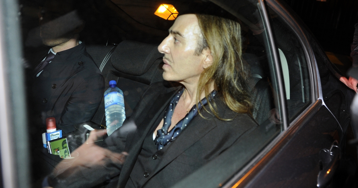 John Galliano leaves in a car after he stood trial for anti-semitic insults in Paris on June 22, 2011</p>