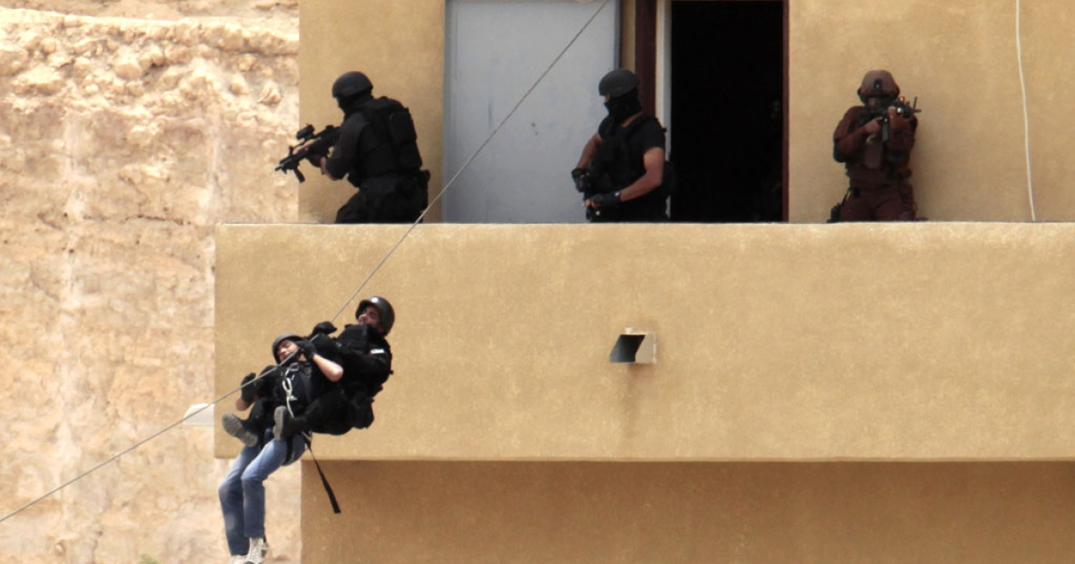 Jordanian special forces demonstrate a mock hostage rescue operation at the King Abdullah Special Operations Training Centre in Amman on May 27, 2012 during their