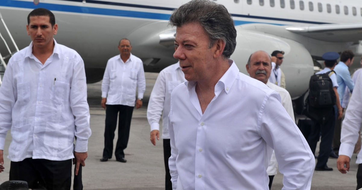 Colombian President Juan Manuel Santos speaks to journalists upon his arrival at the José Martí international airport in Havana, on March 7, 2012.</p>