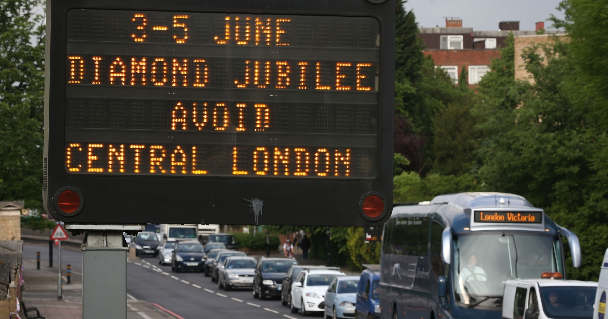 A matrix road sign warns drivers of traffic problems for the extended Diamond Jubilee weekend on June 1, 2012 in London.</p>