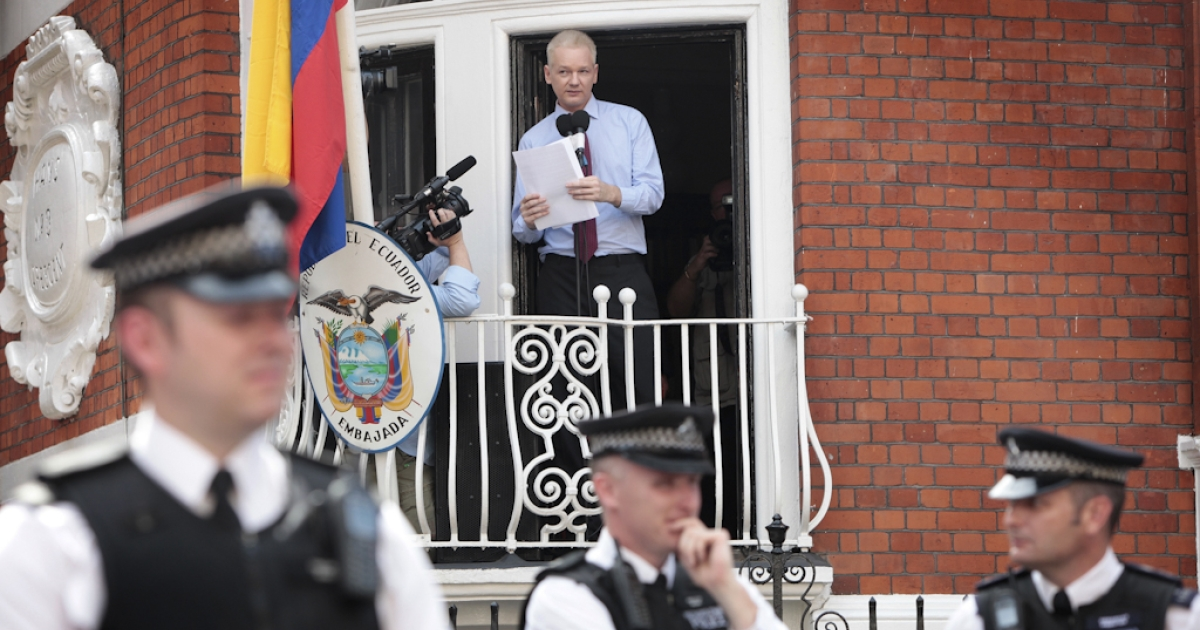 WikiLeaks founder Julian Assange addresses the media and his supporters from the balcony of the Ecuadorean Embassy in London on August 19, 2012. Julian Assange praised the