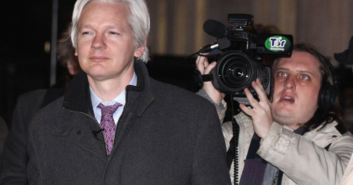 Julian Assange, left, the founder of whistle-blowing website WikiLeaks, leaves the Supreme Court today in London.</p>