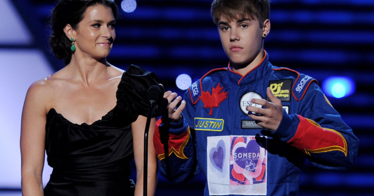 Indy Car driver Danica Patrick (L) and singer/musician Justin Bieber appear onstage to present Best Team at the The 2011 ESPY Awards at the Nokia Theatre L.A. Live on July 13, 2011 in Los Angeles, California.</p>