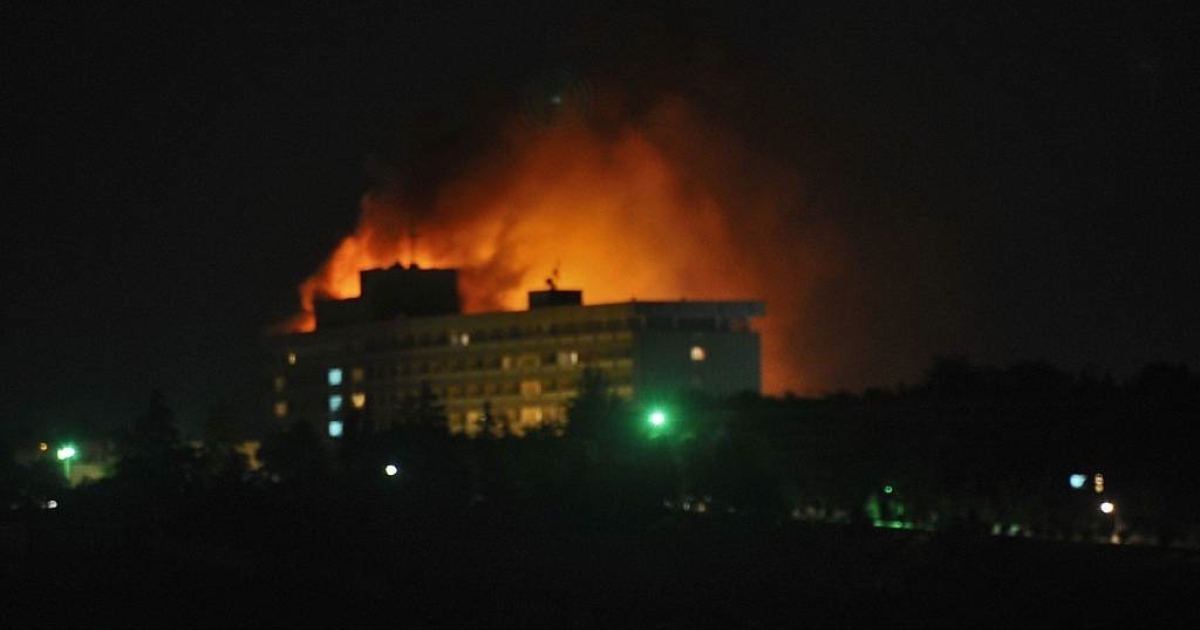 Smoke and flames light up the night from a blaze at the Intercontinental hotel after an attack on the hotel by Taliban fighters and a response by Afghan security forces backed by NATO helicopters in Kabul on June 29, 2011.</p>
