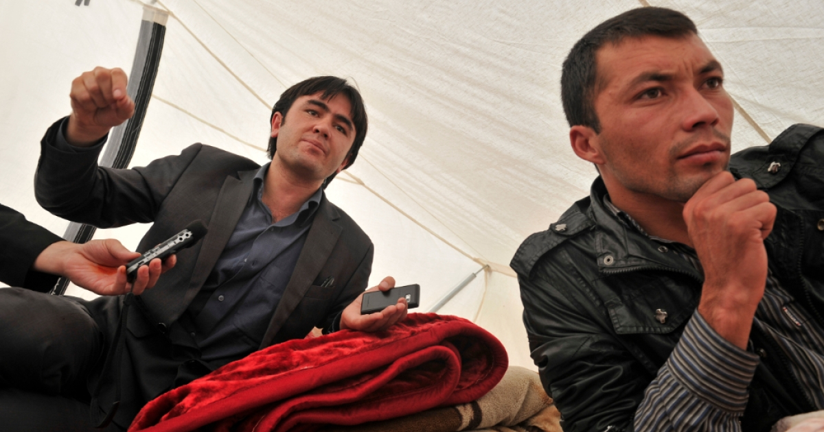 Fights broke out between students at Kabul University today, killing at least one and wounding six students. Here, young university students lie inside a protest tent outside parliament in Kabul on October 12, 2011.</p>