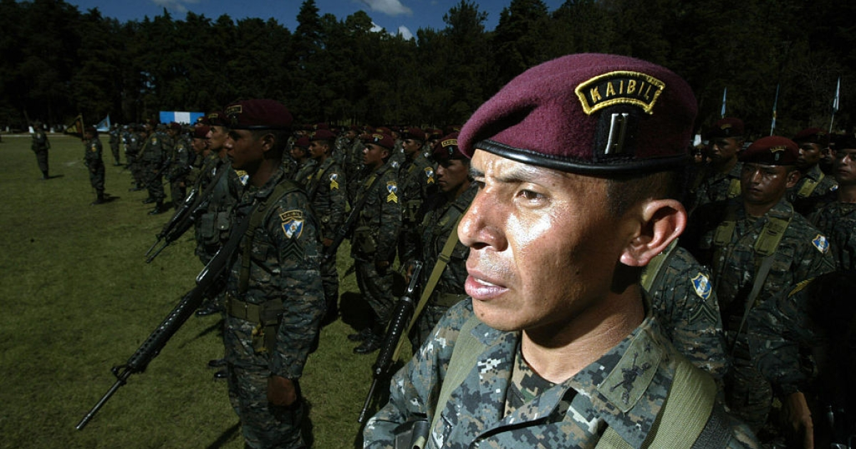 Guatemalan soldiers of the Kaibiles Unit listen the speech of President Alvaro Colom (out of frame) during a ceremony at the Mariscal Zavala Brigade in Guatemala City in 2008.</p>
