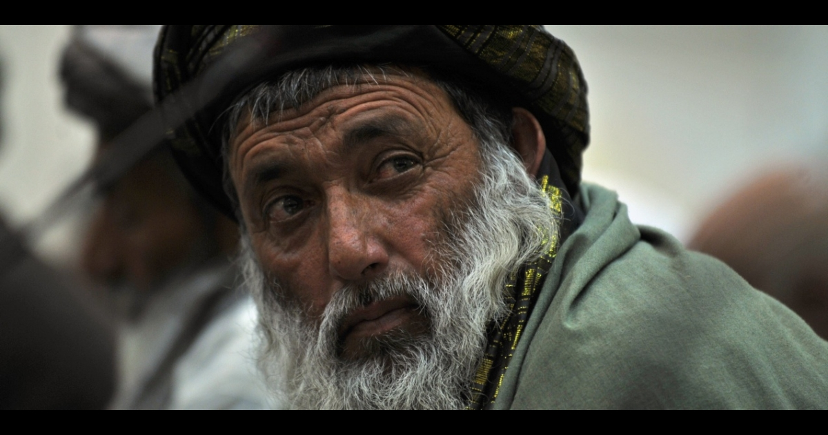 An Afghan elder looks on during President Hamid Karzai's meeting in Kabul on March 16 with residents of the two villages where Staff Sgt. Robert Bales allegedly shot and killed 16 people. Eyewitnesses described seeing multiple shooters while the US military officials maintain it was the act of a lone soldier.</p>