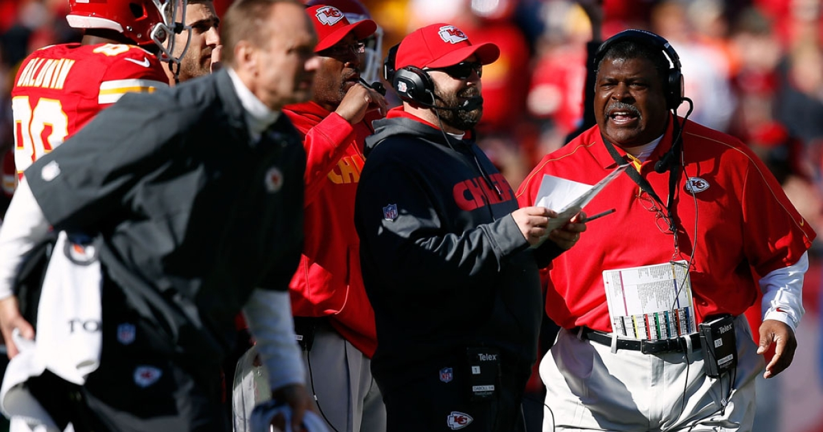 Head coach Romeo Crennel of the Kansas City Chiefs talks with coaches during the game against the Denver Broncos at Arrowhead Stadium on November 25, 2012 in Kansas City, Missouri.</p>
