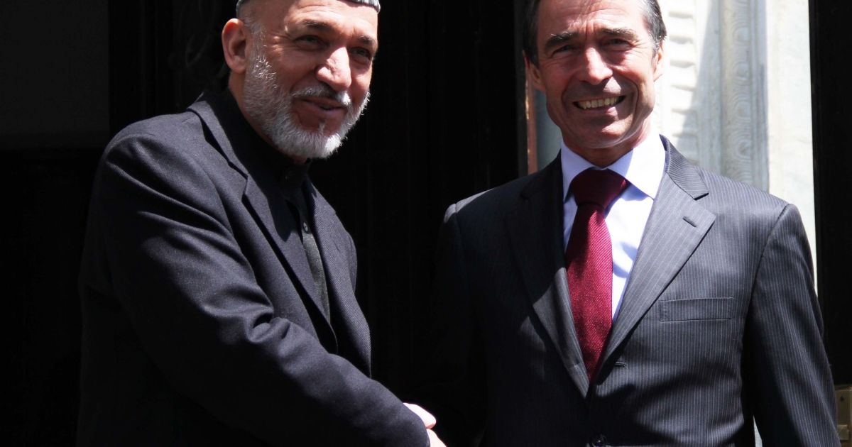 NATO Secretary General Anders Fogh Rasmussen shakes hands with Afghan President Hamid Karzai during a joint press conference at the presidential palace in Kabul, Afghanistan, on April 12, 2012.</p>