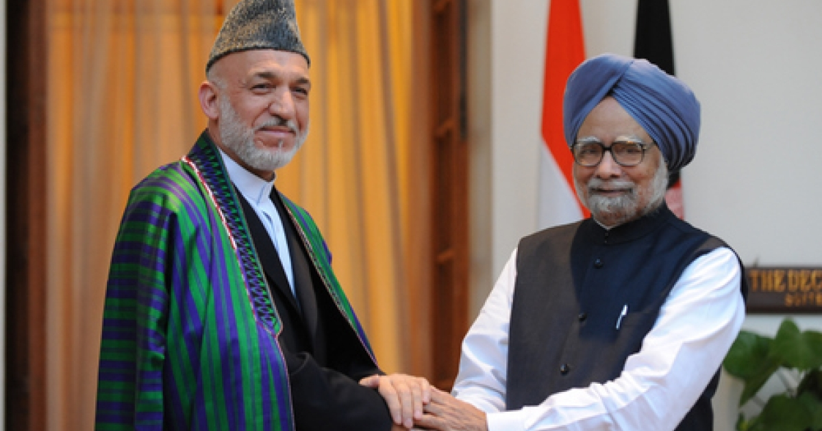 President of Afghanistan Hamid Karzai (L) shakes hands with Indian Prime Minister Manmohan Singh (R) during a meeting in New Delhi on October 4, 2011.  Afghanistan and India, two nations united in their suspicion of Pakistan, are set to forge closer ties as Hamid Karzai visits New Delhi during a highly unstable time in South Asia. The Afghan president, making his second trip to the Indian capital this year, and  meet Indian Prime Minister Manmohan Singh against a backdrop of shifting relations in the war-wracked and nuclear-armed region.</p>