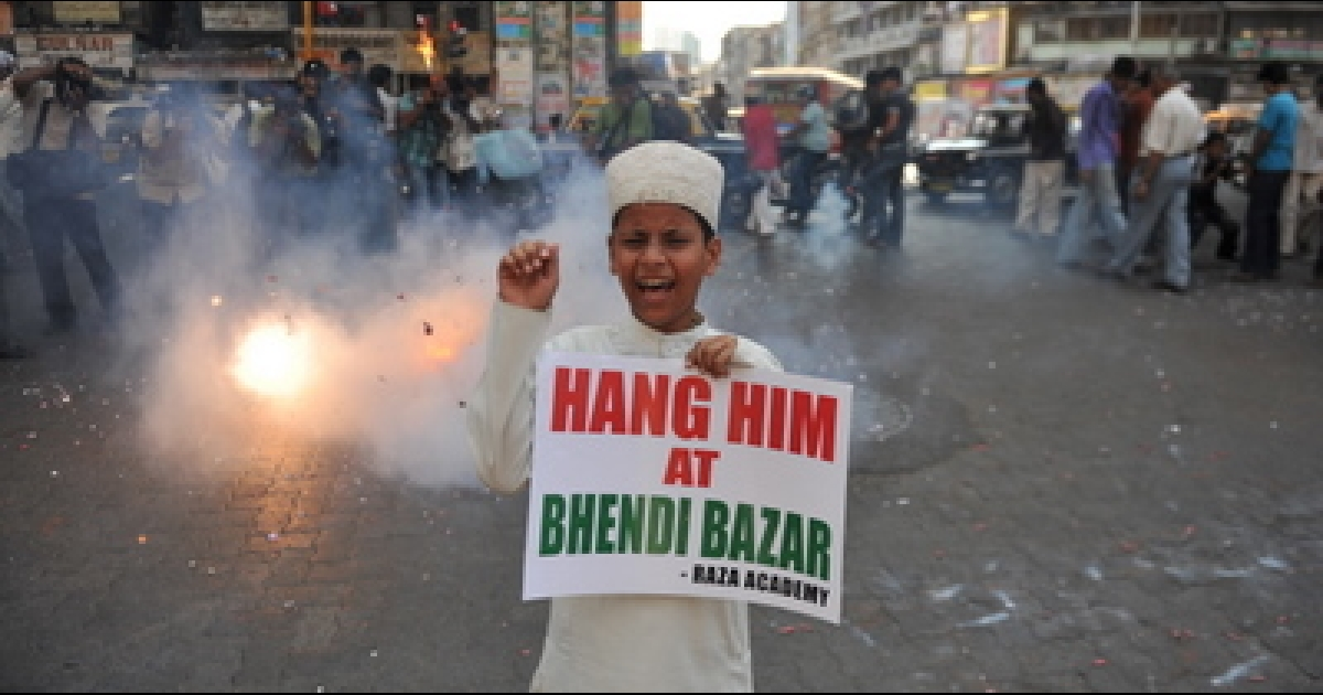 An Indian Muslim child shouts anti-Pakistani slogans during a rally celebrating the sentencing of Mohammed Ajmal Amir Kasab in Mumbai on May 6, 2010.</p>