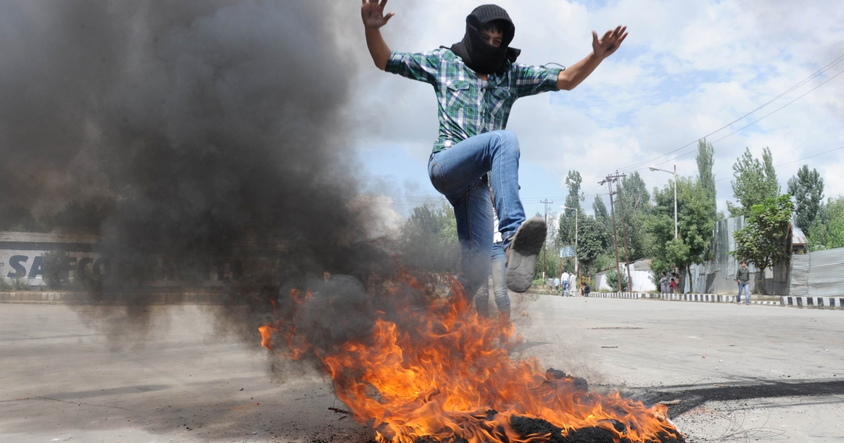 A Kashmiri protester leaps above a burning tire on Sept. 18. He's among a group of angry demonstrators who clashed with Indian police over an anti-Islam film made in the US.</p>