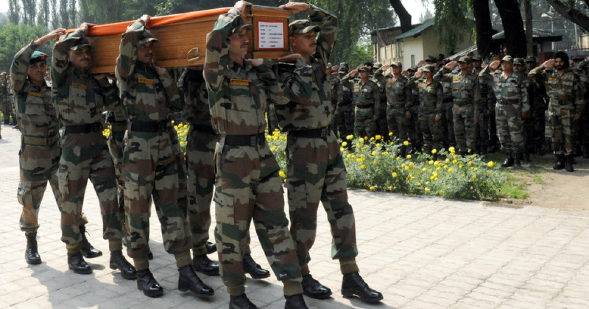 Indian army soldier carry a coffin containing the body of a army officer during a wreath laying ceremony after in Srinagar on August 21, 2011. An Indian army lieutenant and a dozen suspected militants were killed on August 20 in a clash along the de facto border that splits Kashmir between India and Pakistan, the army said. The fighting erupted in the northern Gurez district when a group of