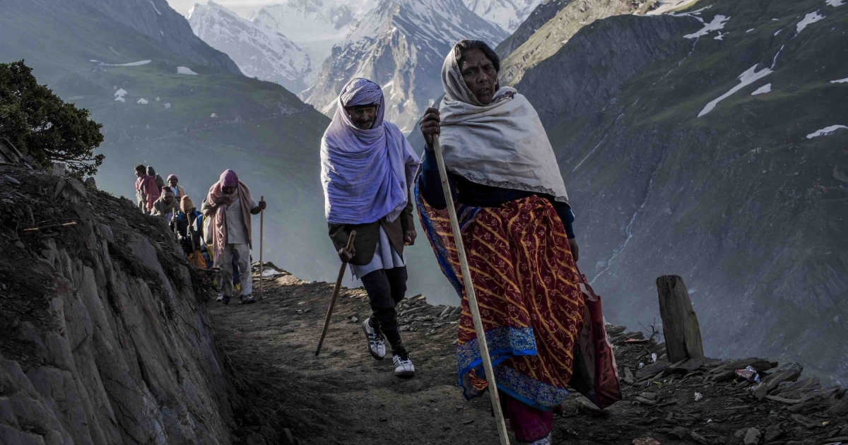 Hindu pilgrims walk along a mountain path as they make their pilgrimage to the sacred Amarnath Cave, one of the most revered Hindu shrines, on June 30, 2012 near Baltal, Kashmir, India. Kashmiri separatist groups recently welcomed tourists to visit the beleaguered region, in a significant shift. But now conservatives are calling for a dress code to make sure foreigners honor local customs.</p>