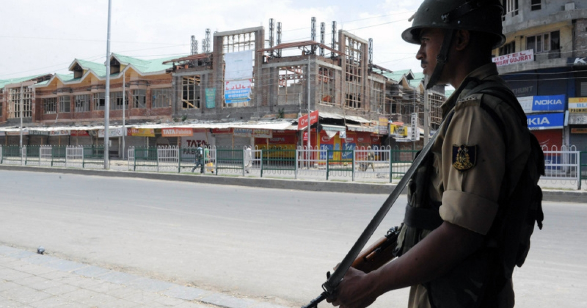 An Indian paramilitary soldier stands guard during a strike in Srinagar on August 3,2011. A one-day general strike called in Indian Kashmir by separatists to protest the death of a shopkeeper in police custody closed down shops, schools and offices.</p>