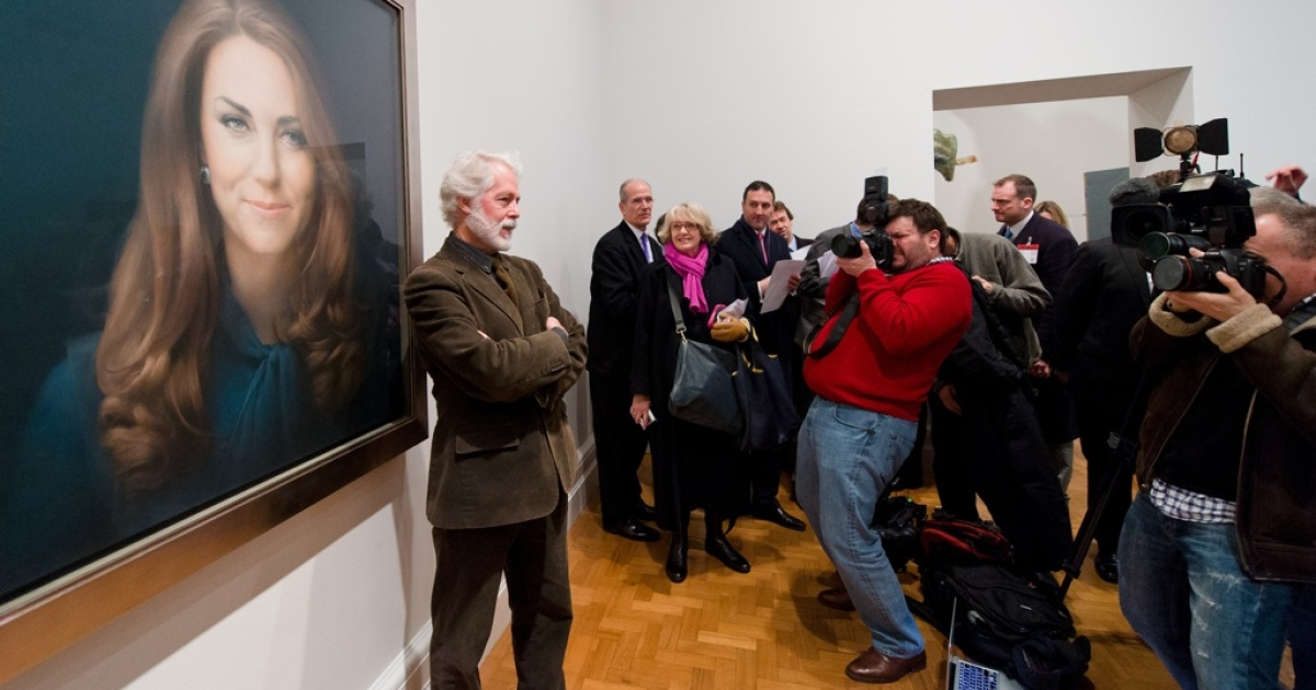 Artist Paul Emsley poses in front of his portrait of Catherine, the Duchess of Cambridge, after its unveiling at the National Portrait Gallery in central London on January 11, 2013. This is the first official portrait of the Duchess and was completed after two sittings at the artist's studio and Kensington Palace.</p>